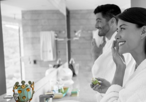 Portrait of a loving couple in the bathroom getting ready in the morning - lifestyle concepts
